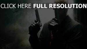 hitman visage pistolet costume chauve tueur