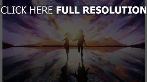 couple coucher du soleil courir réflexion