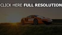 mclaren orange champ coucher du soleil voiture sportive de prestige
