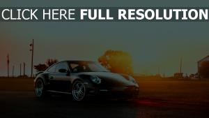 porsche 911 coucher du soleil noir réflexion