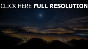 autriche montagne nuit vue aérienne lumière