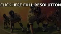 football américain équipe pose de combat