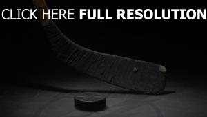 bâton rondelle gros plan hockey