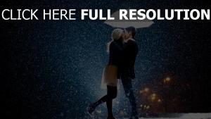 couple parapluie lumineux tempête de neige