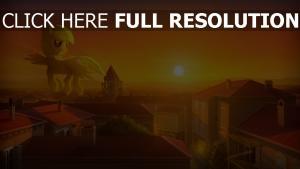 licorne gigantesque coucher du soleil toit